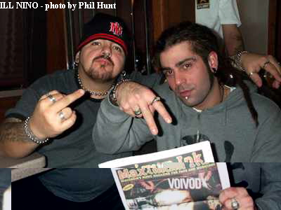 ILL NINO holding Max Ink, photo by Phil Hunt